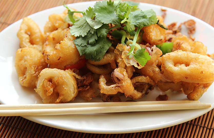 Stir-Fried baby Calamari with Mild, pickled Chili. 轻度,腌辣椒,炒出炸鱿鱼. Photograph Copyright 2012 Chuck Dorris, eDining.us. All Rights Reserved